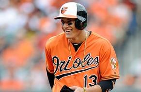 Manny Machado smiles orange